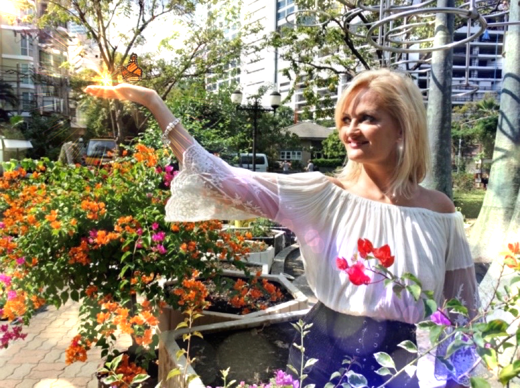 Debbie with Butterfly and Solar Flares